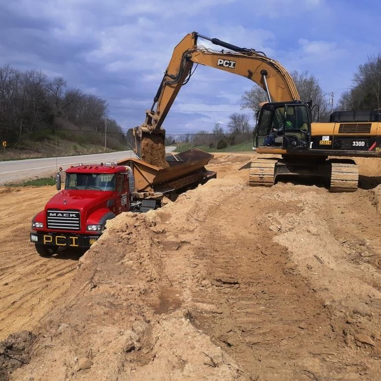 Moving earth near Burlington Road for improved roadway alignment.